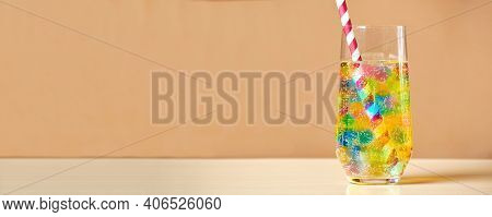 Multi-colored Cocktail Glass With Gum Jelly Balls And Fizzy Drink Inside. Backdrop And Copy Space Fo