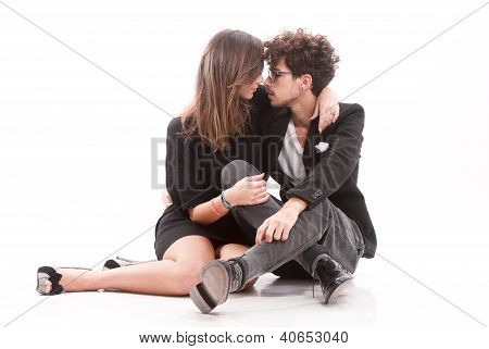 Romantic Young Couple Sitting Together On White