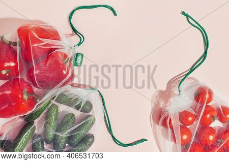 Reusable Packaging Of Products By Weight. Red Bell Peppers, Cucumbers And Tomatoes In A Reusable Bag