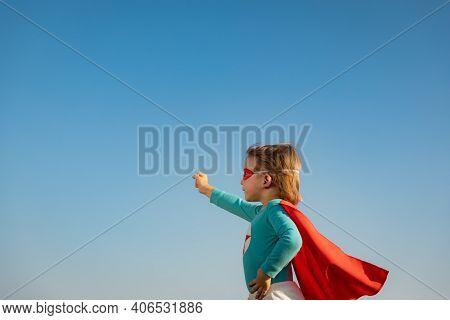 Superhero Child Against Blue Summer Sky Background. Super Hero Kid Having Fun Outdoor. Freedom And I