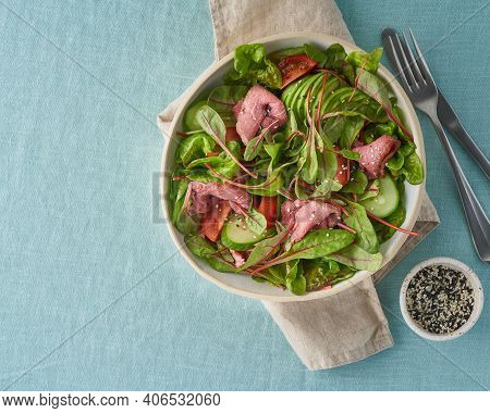 Keto Salad With Roast Beef Meat Sous Vide, Tomatoes, Cucumbers, Avocado On Pastel Linen Tablecloth.
