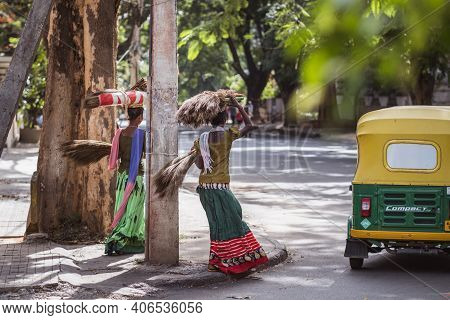 Bengaluru, India - June 08, 2020. Indian Women In Colorful Sarees Carrying A Bundle On Head. India,