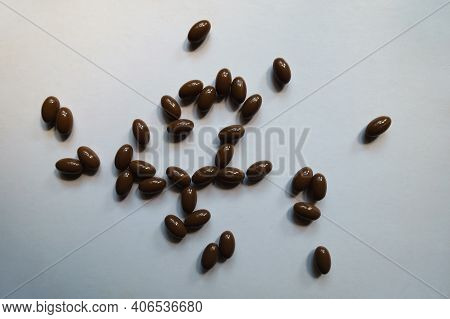 Multiple Brown Softgel Capsules Of Vitamin D3 From Above