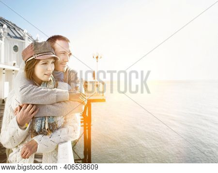 Affectionate couple standing on pier