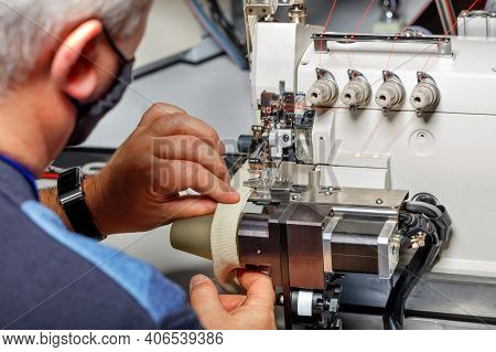 The Hands Of An Old Master Set Up A Modern Electric Sewing Machine And Check The Quality Of The Stit