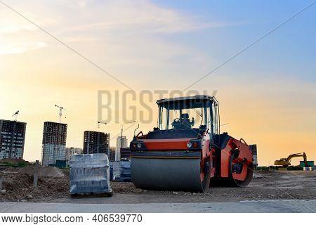 Paving Roller Machine During Road Work At Construction Site For Paving Works. Asphalt Paver Road Rol