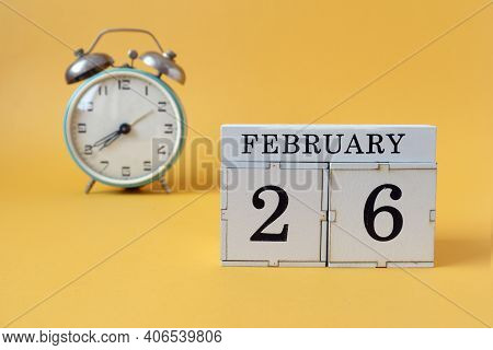 Calendar For February 26 : Cubes With The Number 26 And The Name Of The Month, Alarm Clock On A Yell