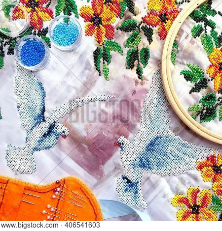 Beads Embroidery Of Dove Birds & Orange Flowers With Leaves. Embroidery Beads Work On Table - Beads,