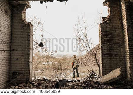 Wandering Boy. Boy With A Gun. Boy Goes To An Abandoned Building. Boy Stands In Front Of A Building.