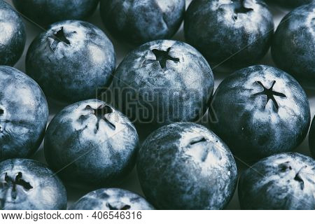 A Full Frame Food Background Of A Close Up Of Fresh, Ripe Blueberries Packed Together With Copy Spac