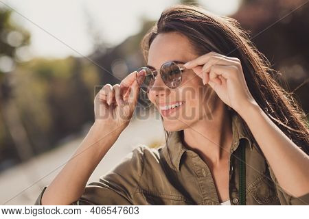 Profile Side Photo Of Charming Shiny Young Woman Dressed Brown Shirt Smiling Hands Arms Eyewear Outd