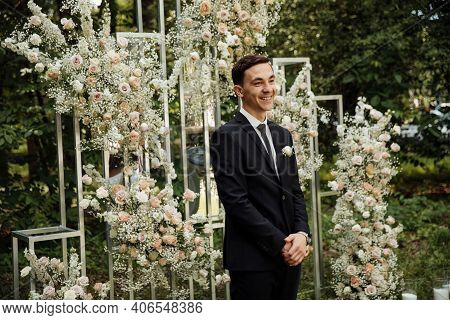 The Groom Stands Near The Altar. Wedding Ceremony Where The Happy Groom Is Waiting For The Bride. We