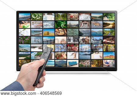 Online Tv, Streaming Vod Service Concept. Male Hand Holding Tv Remote Control. Television Streaming