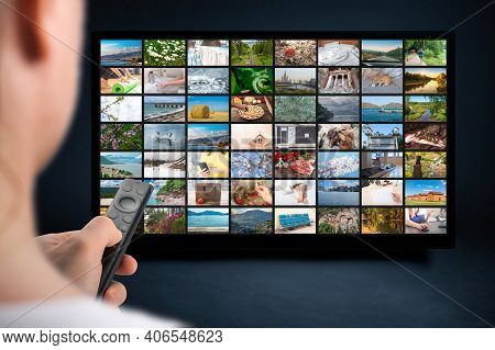 Person Holds Remote Control. Vod Content Provider Concept. Television Streaming Video Concept. Media