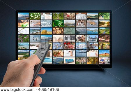 Male Hand Holding Tv Remote Control. Multimedia Streaming Concept. Vod Content Provider Concept. Tel