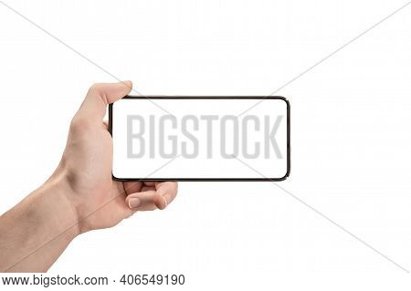 Mockup Phone Horizontal. Hand Holding The Black Smartphone And Modern Frameless Design. Isolated Man