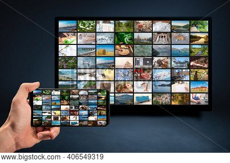 Man Holding Mobile Phone With Many Icons Of Video Service On Demand On Background Oline Tv Vod Provi