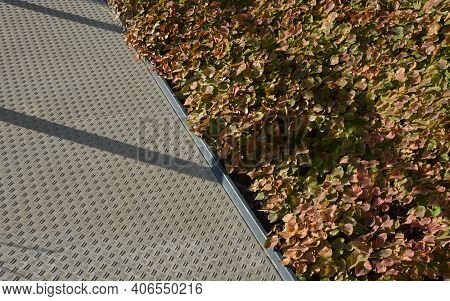 Concrete Monolith Staircase With The Texture Of Extruded Ribbed, Corrugated Sheet Metal. Ramp With V