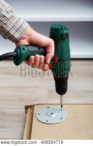 Furniture Assembly Process, Master Collects Table Furniture Using Drill Tool Instrument. Moving, Hom