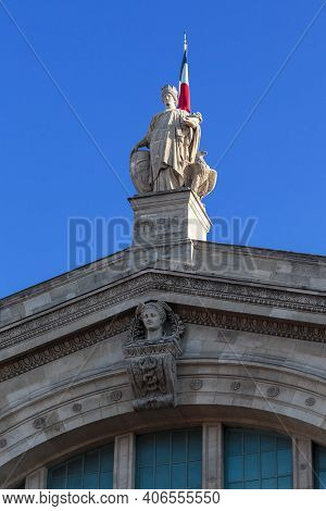 Paris, France - August 30, 2019: It Is A Statue Of An Allegory Of Paris On The Pediment Of The Gare