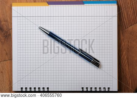 Paper Background From An Open Tear-off Notebook For Notes, Sheets In A Box With A Ballpoint Pen Clos