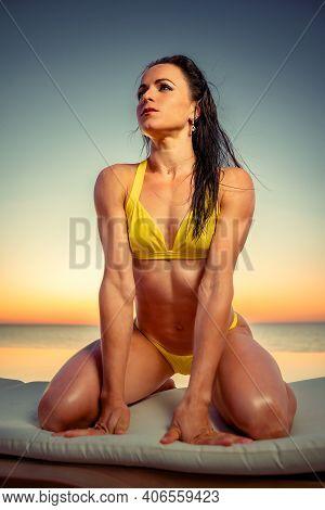 Portrait Of A Tanned Brunette Woman In Bikini Near The Pool