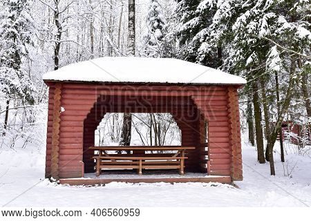 Wooden Gazebo For Relaxation And Barbecue. Log Cabin In Forest For Camping And Weekend. Wooden Garde