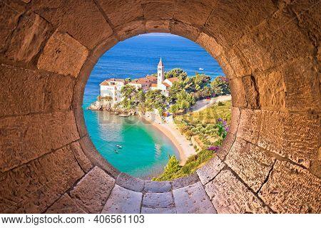 Bol On Brac Island. Monastery On Pebble Beach In Bol View Through Stone Window, Island Of Brac, Arch