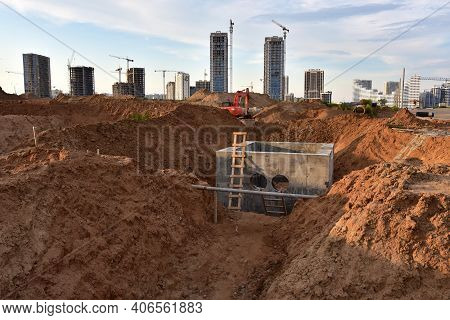 Construction Of Stormwater Pits, Sanitary Sewer System Distribution Chamber And Pump Station. Sewera