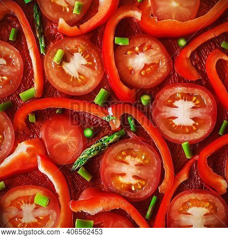 Top View Of A Vegetarian Italian Dish With Sliced Tomatoes, Bell Peppers, Green Fresh Asparagus And
