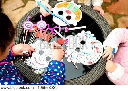 Happy Children Draw With Pencils Clown Mask. Close Up Of Hands Little Boy And Girls Sitting In Playr