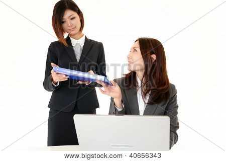 Businesswomen discussing plans