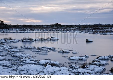 Ice Covered Flooded Grassland In Winter Season