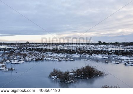 Flooded And Icy Landscape At The Stora Alvaret On The Island Of Oland In Sweden
