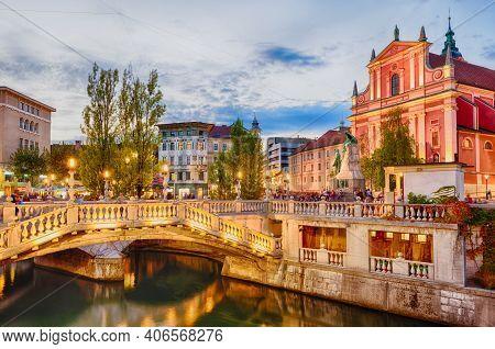 Ljubljana, Slovenia - September 23, 2016: Tromostovje In The City Center In The Soft Evening Light.