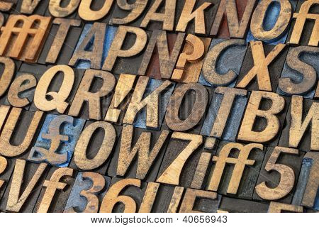 alphabet abstract - vintage letterpress wood type printing blocks stained by black, blue and red ink