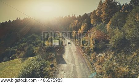 Mountain Hill Country Road Car Drive Aerial View. Roadside Automobile Highland Scenery Landscape Overview. Dense Green Forest Unpolluted Natural Environment Concept.