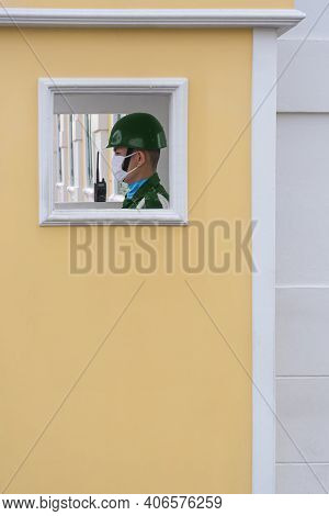 Bangkok, Thailand - August 29,2020 : Side View Of Asian Sentry Is Standing On Duty At The Yellow Sen