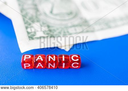 The Word Panic Composed Of Letters On Cubes And Money. Financial Market Panic