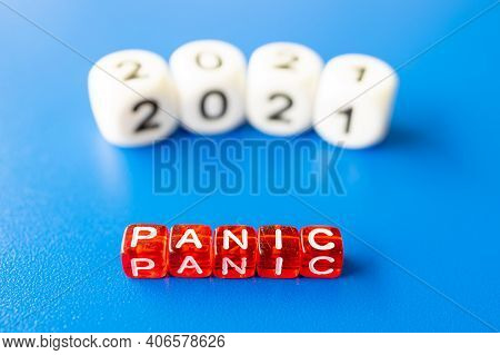 From Cubes Laid Out 2021 In Blur And Out Of Focus, In The Foreground The Word Panic. Year Of Panic