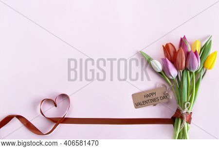 Heart Shape Ribbon Attached To A Bunch Of Flowers With Valentines Day Greeting
