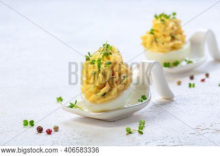 Creamy Eggs With Micro-green Arugula.
