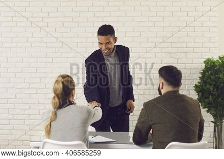 Happy African-american Man Shaking Hands With Hr Managers After Getting Job At The Company