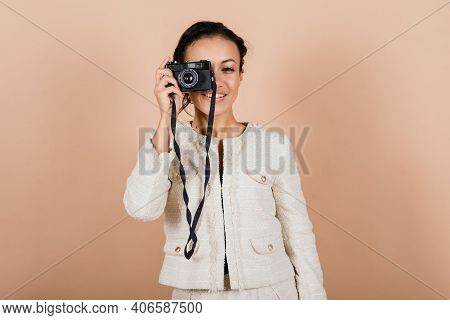 Pleasant African Young Woman Making Photos, Studio Shoot
