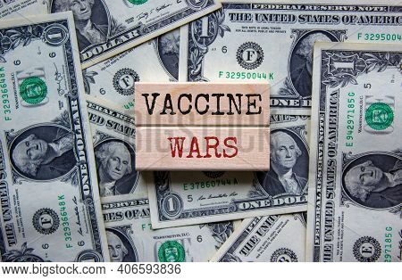 Covid-19 Vaccine Wars Symbol. Concept Words 'vaccine Wars' On Blocks On A Beautiful Background From