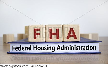 Fha Symbol. Wooden Blocks And Book With Words 'fha Federal Housing Administration'. Beautiful White