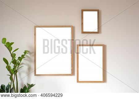 Interior Design Of Living Room With Two Brown Mock Up Photo Frame On Modern Wall, Blank Canvas With