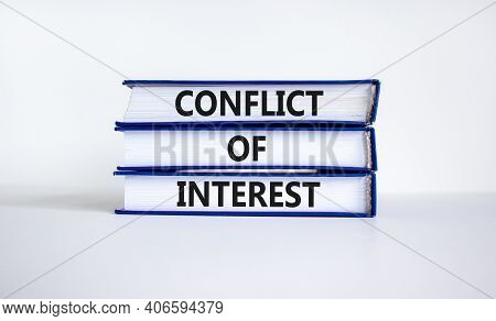 Conflict Of Interest Symbol. Books With Words 'conflict Of Interest'. Beautiful White Background. Co