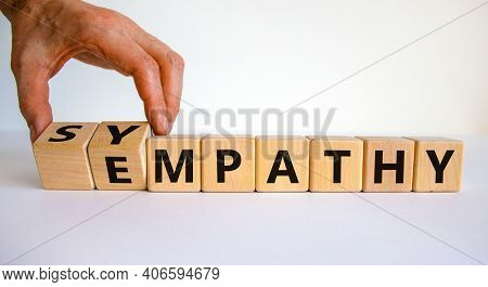 Sympathy Or Empathy Symbol. Businessman Turns Wooden Cubes And Changes The Word 'empathy' To 'sympat