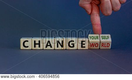 Change World Or Yourself Symbol. Businessman Turns Wooden Cubes And Changes Words 'change World' To